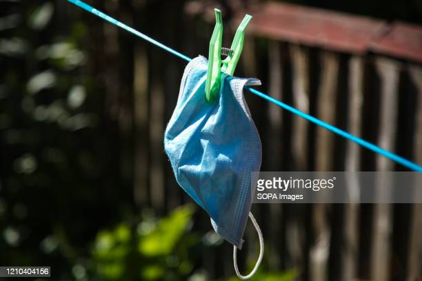 Washed face mask hangs on a clothesline to dry during coronavirus crisis.