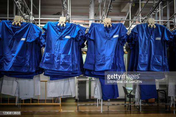 Washed linen is pictured at the central laundry of the AP-HP La Pitie-Salpetriere Hospital on January 26, 2021 in Paris.