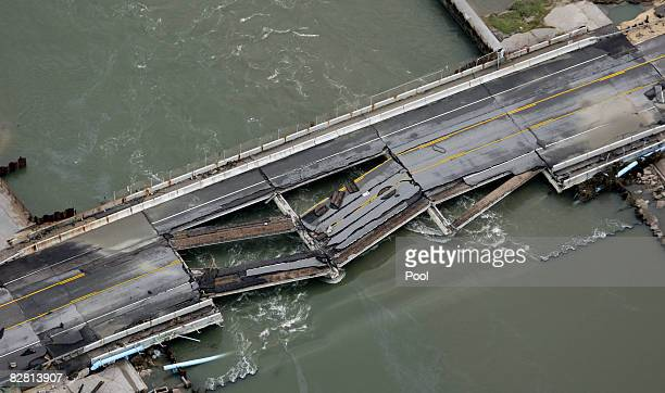 A washed out bridge is shown after Hurricane Ike September 14 2008 in Gilchrist Texas Floodwaters from Hurricane Ike are reportedly as high as eight...