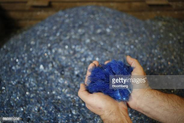 Washed polyester Xray film is displayed for a photograph before being recycled into silver nitrate at the Rochester Silver Works LLC facility in...