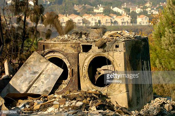 A washer and dryer stand in the wreckage of a home in Rancho Bernardo California US following the Witch fire on Friday Oct 26 2007 Firefighters in...