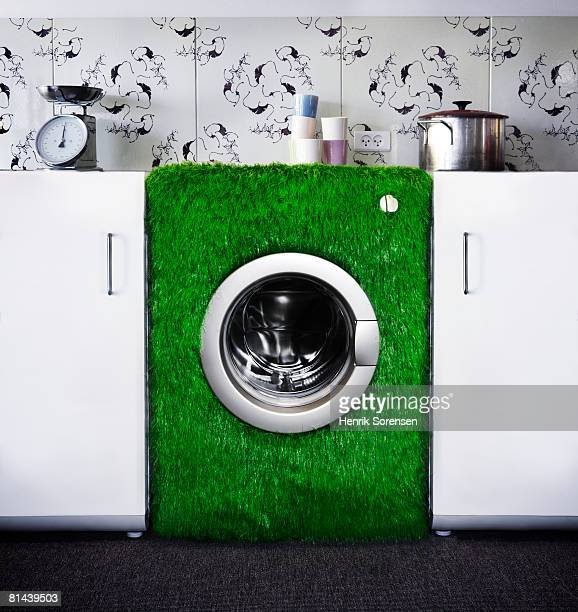 Washer covered with grass.