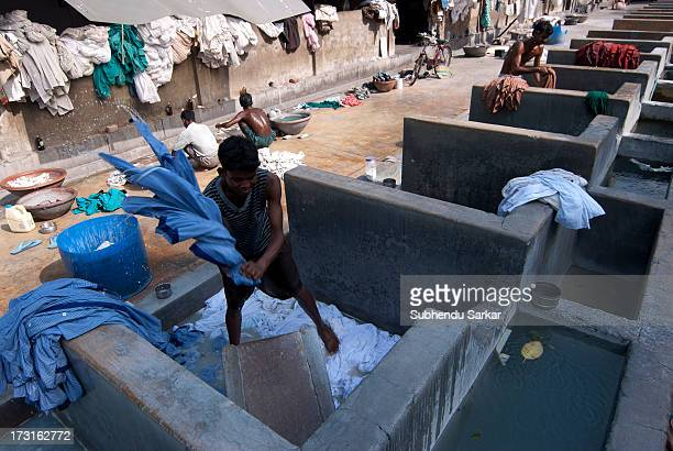 Washerman washes clothes in Kolkata