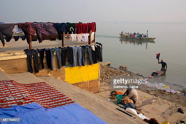 Washermen engaged in washing and drying clothes on the ghats of Varanasi Varanasi is a holy city on the banks of the Ganges