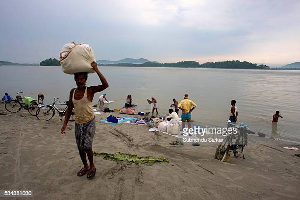 Washermen wash clothes on the bank of the river Brahmaputra in the early morning in Guwahati The Brahmaputra also called TsangpoBrahmaputra is a...