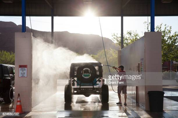 washing 4 wheel drive jeep. - western usa stock pictures, royalty-free photos & images