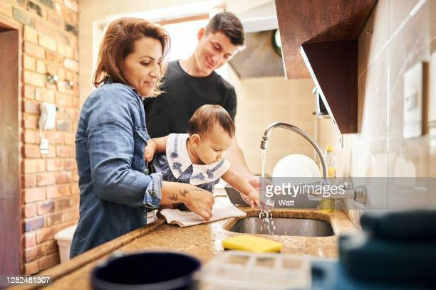 washing baby's hands - kitchen sink stock pictures, royalty-free photos & images
