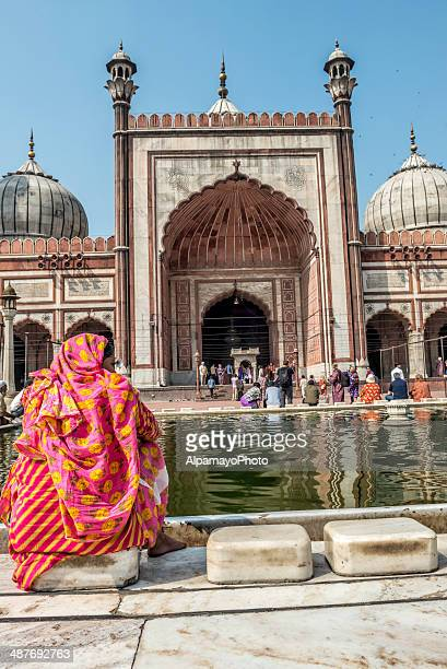 washing before the prayer at jama masjid in old delhi - old delhi stock pictures, royalty-free photos & images