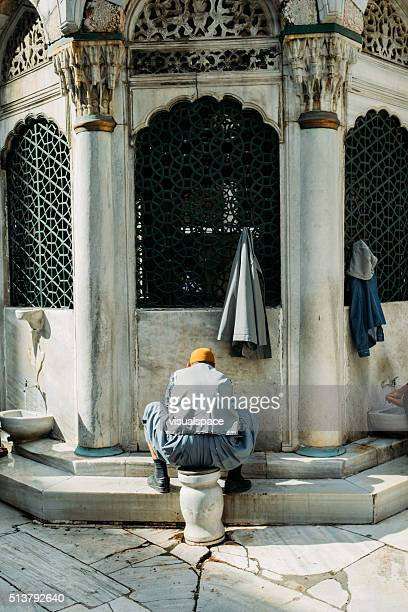 washing before the prayer at süleymanniye mosque - foot worship stock pictures, royalty-free photos & images