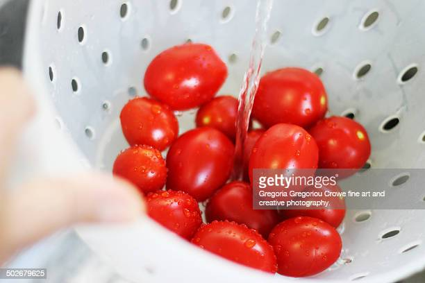washing cherry tomatoes - gregoria gregoriou crowe fine art and creative photography. stock pictures, royalty-free photos & images