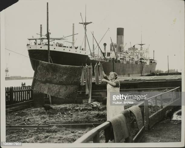 Washing Day In Dockland The wife of a Newport dock worker hanging out the washing with a steamer almost in her back garden South Wales