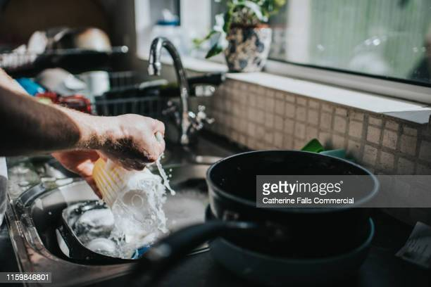 washing dishes - crockery stock pictures, royalty-free photos & images