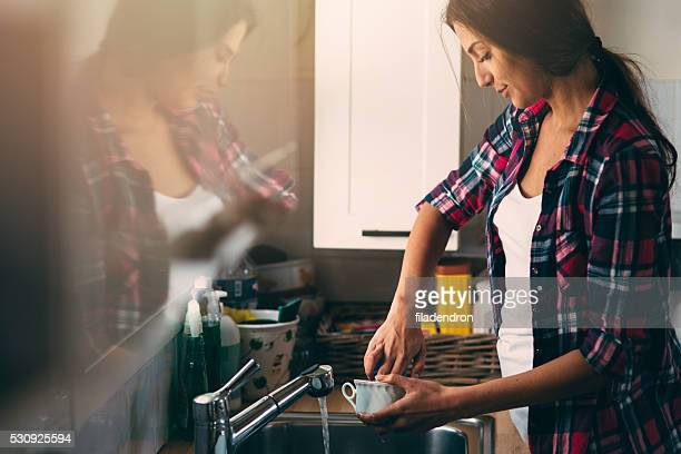 washing dishes - dishwashing liquid stock photos and pictures