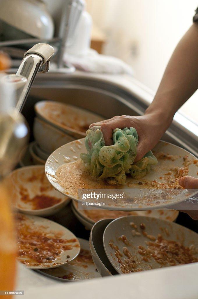 Washing dishes with sponge : Stock Photo