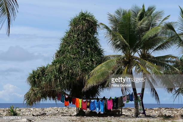 Washing dries in the trees next to the ocean on August 15 2018 in Funafuti Tuvalu The small South Pacific island nation of Tuvalu is striving to...