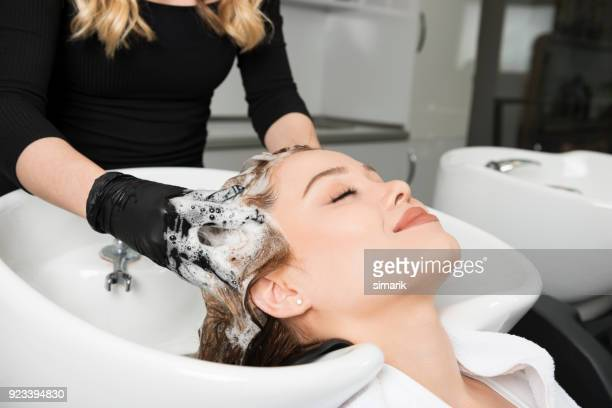 washing hair - hair salon stock pictures, royalty-free photos & images