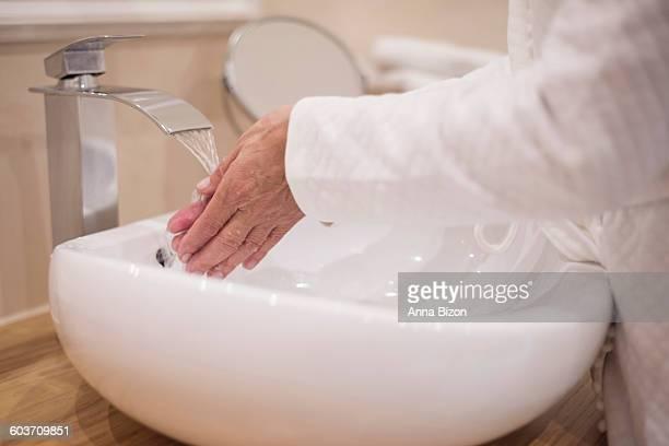 Washing hands in the bathroom. Debica, Poland