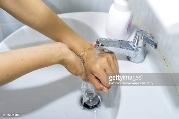 washing hands rubbing with soap for prevent the spread of germs and bacteria and avoid infections corona virus. hygiene concept - foam finger - fotografias e filmes do acervo