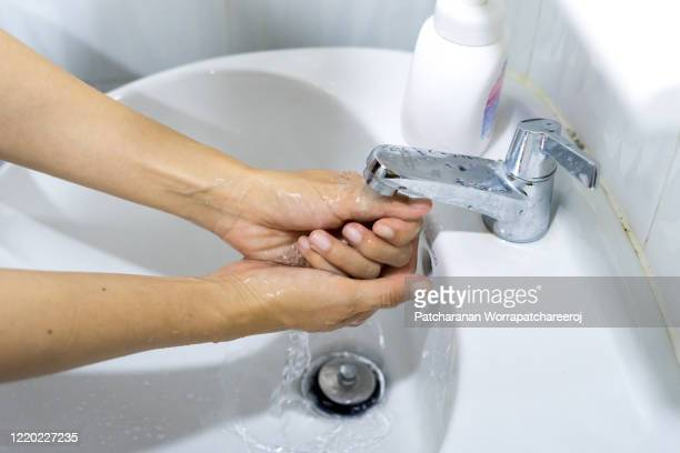 washing hands rubbing with soap for prevent the spread of germs and bacteria and avoid infections corona virus. hygiene concept, healthcare concept - foam finger - fotografias e filmes do acervo