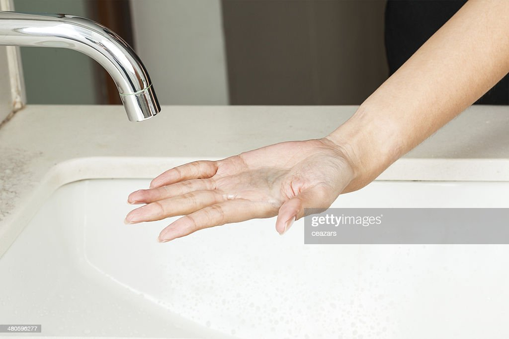 Washing hands with soap : Stock Photo