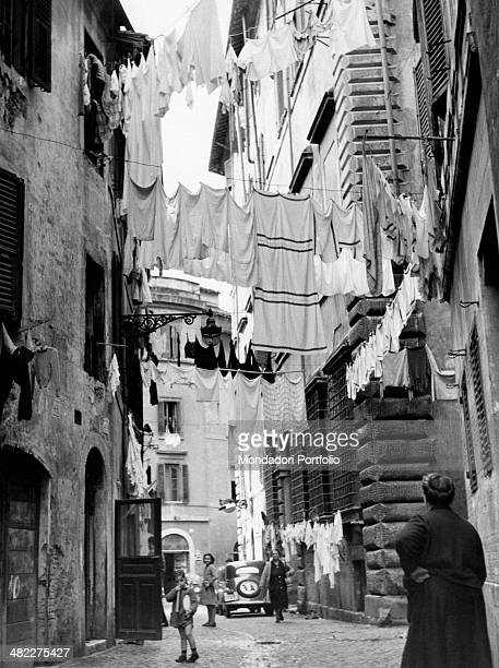 Washing hanged out in a lane of Trastevere in Rome Rome 1950s