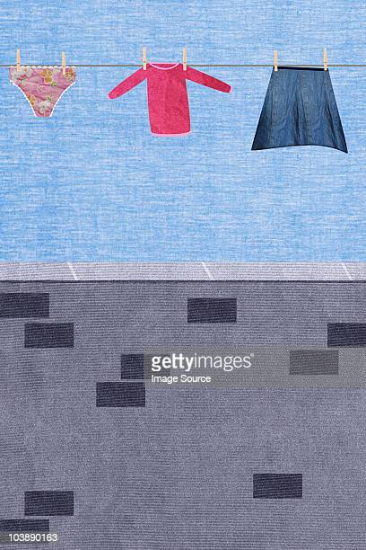 Washing hanging on clothesline with brick wall