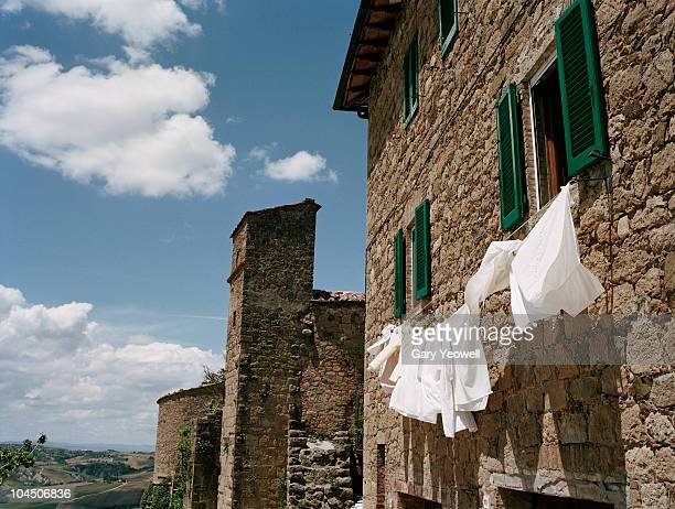 washing hanging outside a house - yeowell stock pictures, royalty-free photos & images