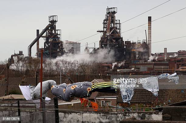 Washing hangs on a line in the garden of a home near the Tata Steel steel plant at Port Talbot south Wales on April 1 2016 Shockwaves rippled through...