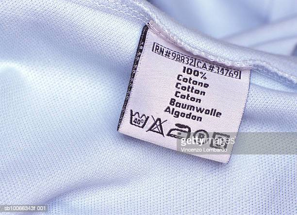 Washing label on white cloth, close-up