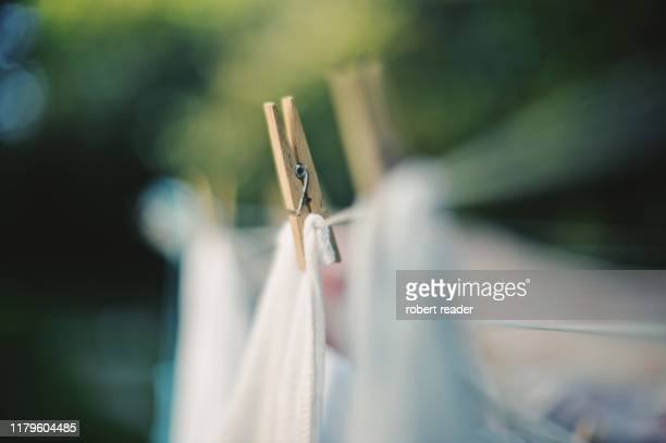 washing line and clothes peg - clothespin stock pictures, royalty-free photos & images