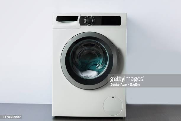 washing machine against wall - washing machine stock pictures, royalty-free photos & images