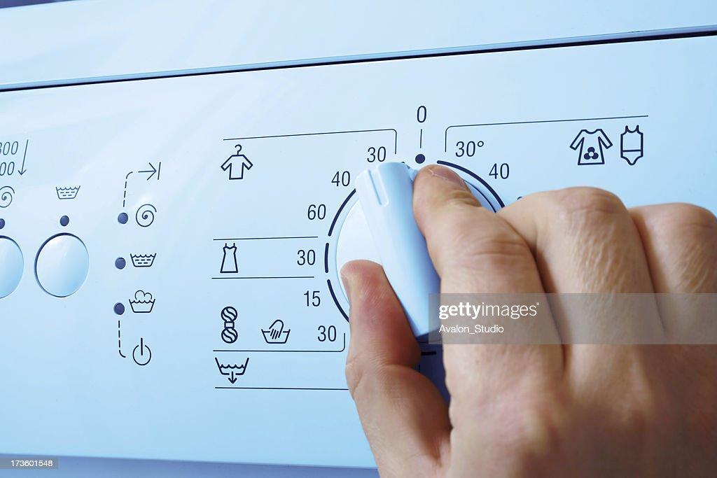 Washing machine and hand : Stock Photo