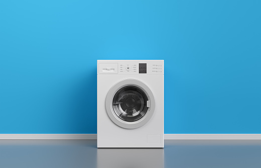 Washing machine at blue wall, frontal view with copy space,3d rendering (general design and captions) 1096523200