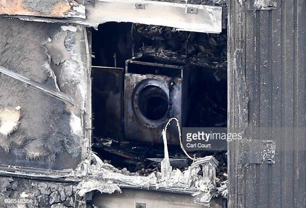 A washing machine is seen amongst the remains of Grenfell Tower on June 16 2017 in London England 30 people have been confirmed dead and dozens still...