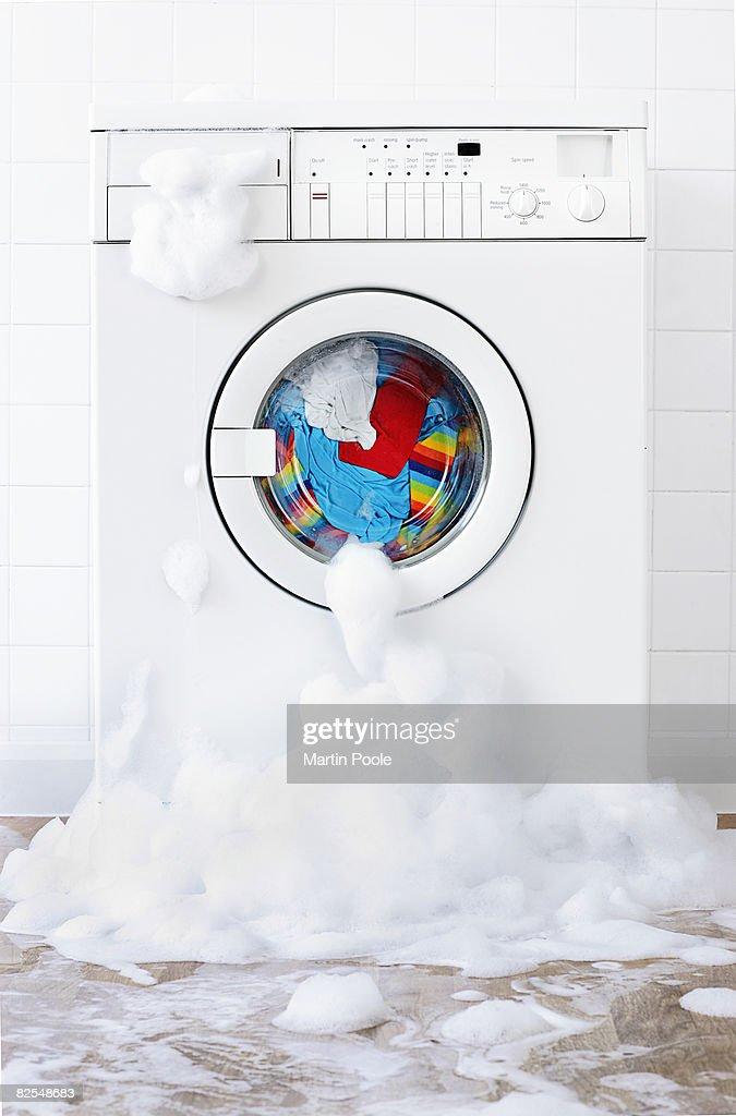 washing machine leaking , in laundry room : Stock Photo