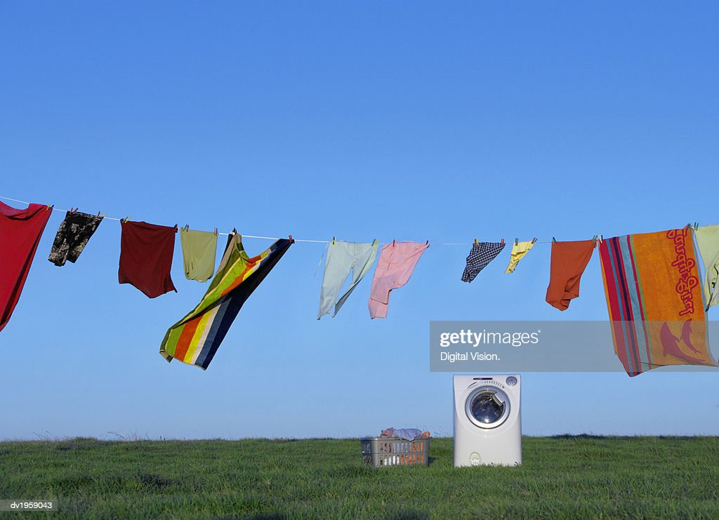 Washing Machine, Washing Line and Laundry Basket on the Grass : Stock Photo