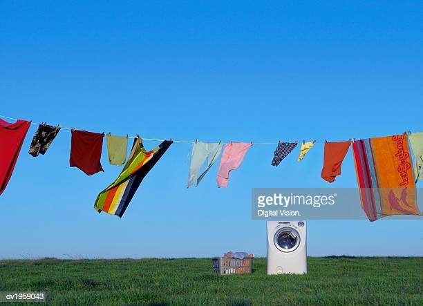washing machine, washing line and laundry basket on the grass - 乾かす ストックフォトと画像