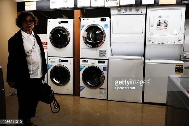 Washing machines and dryers stand in a Manhattan appliance store on September 19 2018 in New York City As President Donald Trump continues to ratchet...