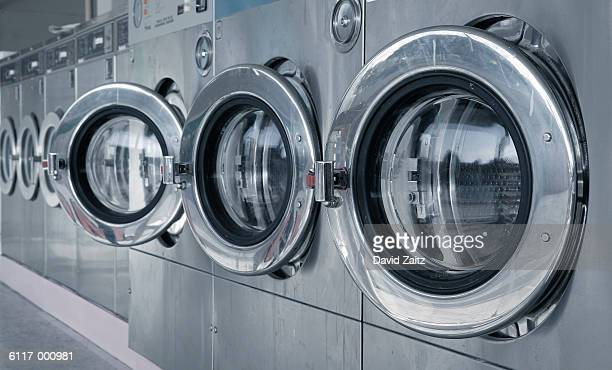 washing machines in laundromat - laundry stock pictures, royalty-free photos & images