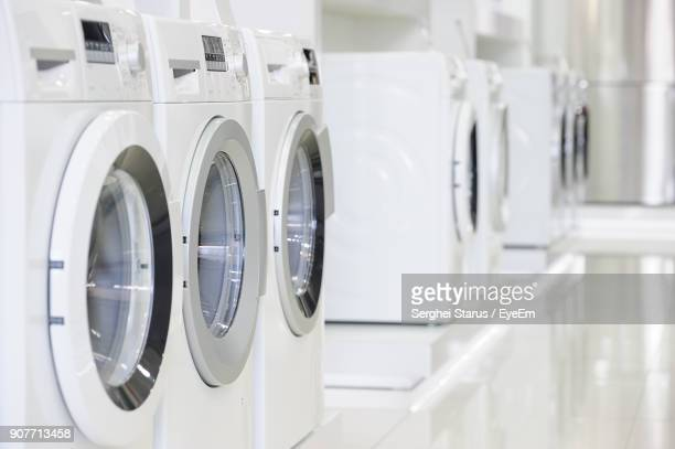 washing machines in laundromat - white goods stock pictures, royalty-free photos & images