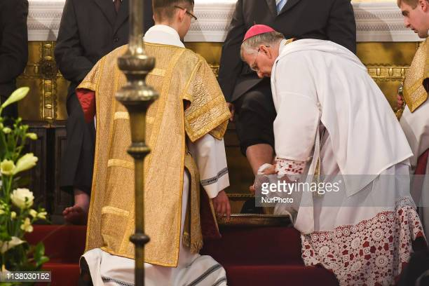 Washing of the Feet by the Archbishop of Krakow Marek Jedraszewski during the Holy Thursday Mass at Wawel Royal Cathedral in Krakow Mateusz...