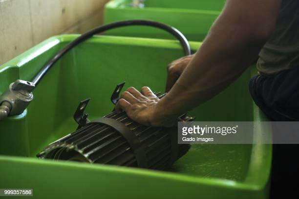 washing part - gado stock photos and pictures