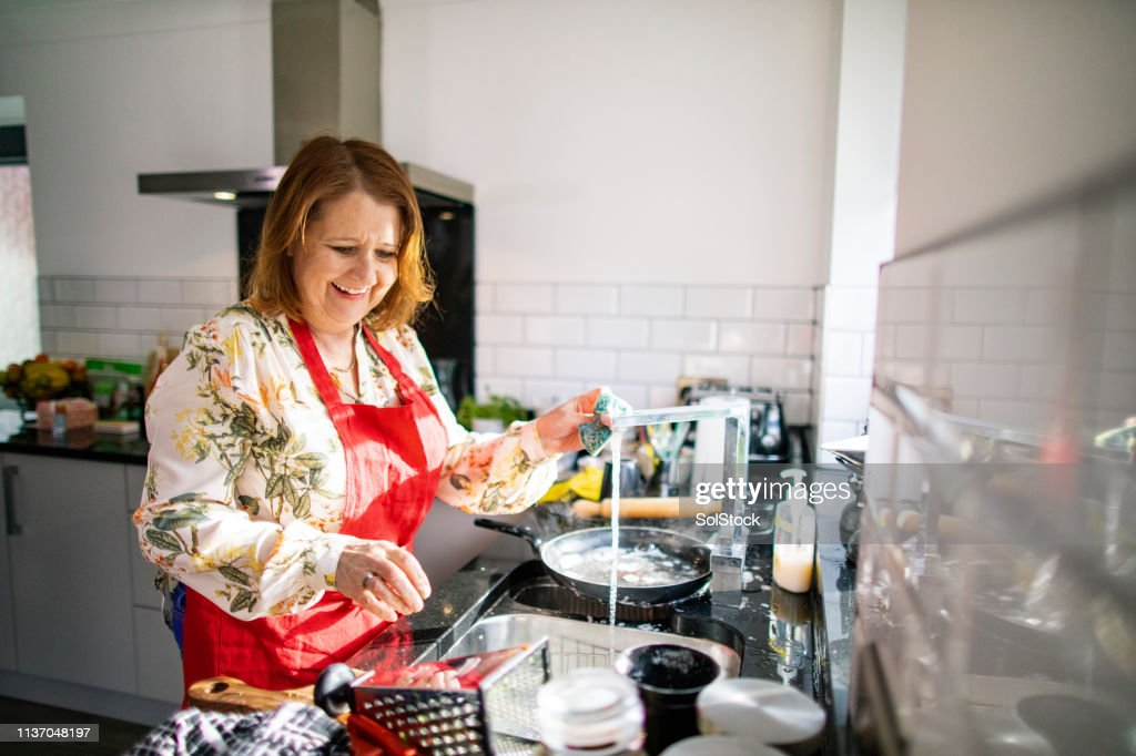 Washing the Dishes After Dinner Party : Stock Photo