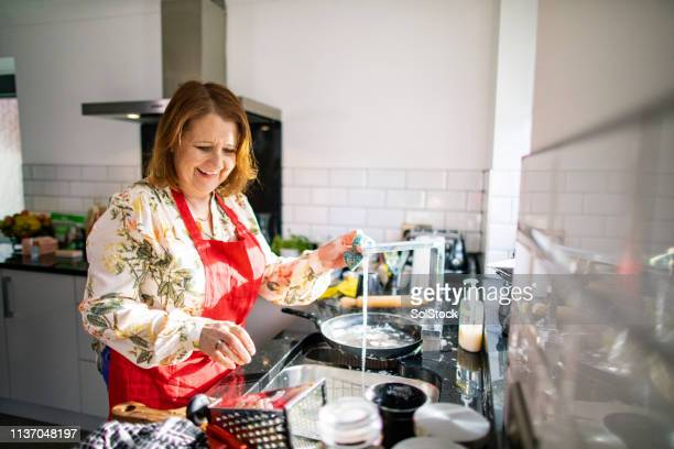 washing the dishes after dinner party - cleaning after party stock pictures, royalty-free photos & images