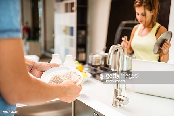 washing the dishes on the kitchen