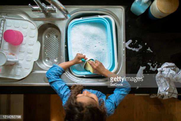 washing the dishes - wash bowl stock pictures, royalty-free photos & images
