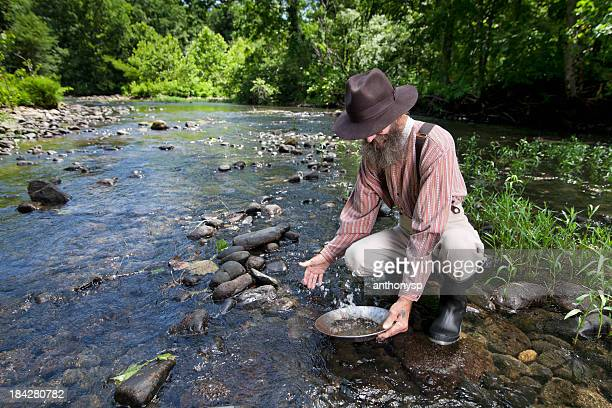washing the find - gold rush stock photos and pictures