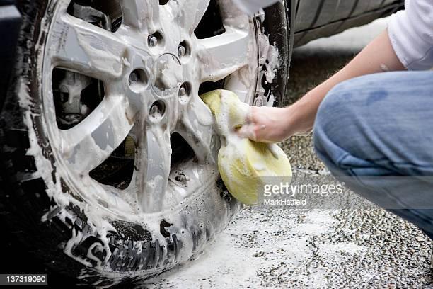 Washing Wheel Of A Car