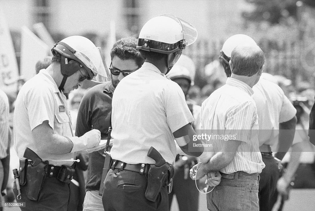 Police Handcuffing a Protester : News Photo