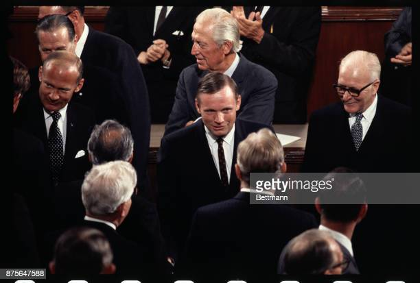After speeches to joint session of Congress September 16th Apollo 11 astronauts Neil Armstrong and Buzz Aldrin are surrounded by Congressmen